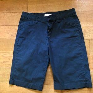 Navy blue Bermuda shorts listed as 12 medium
